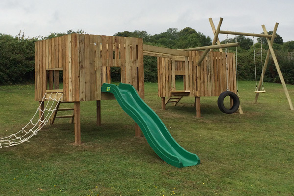 Wooden outdoor climbing set: This climbing set started out as not much more than a lorry-load of timber. If you tell us how big you want it and what accessories you would like - slide, swings, rope ladders etc - we'll build you a castle that will give children years of fun outdoor play.