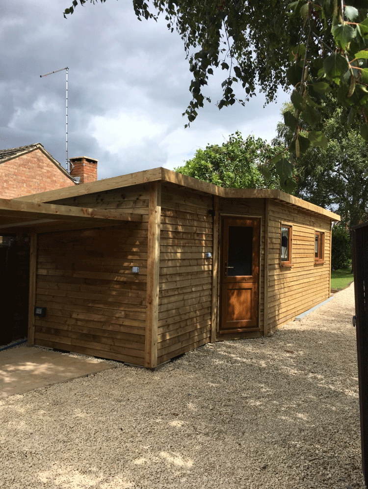 showing what can be done on a modest budget, neil aldridge landscapes  created a bright and uncluttered home gymnasium in one part of this wooden  outbuilding